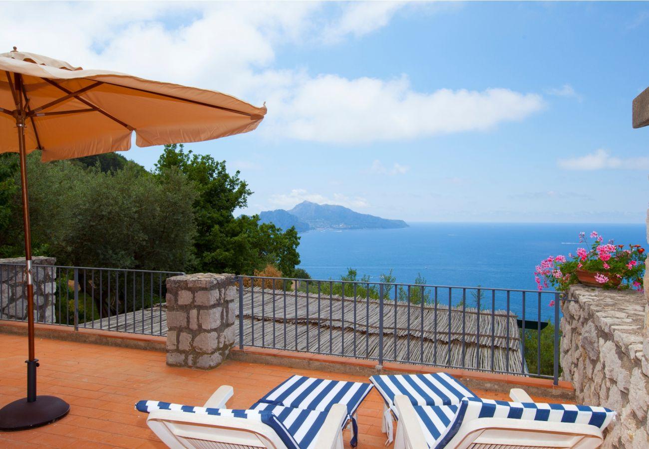 terrace with oanoramic capri view, holiday villa sterlizia, massa lubrense, italy
