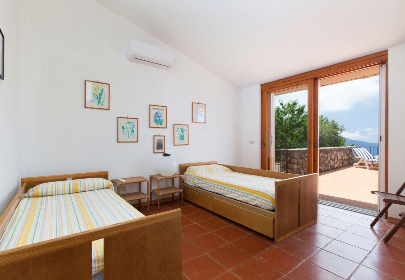 bright twin bedroom with terrace access, holiday villa sterlizia, massa lubrense, italy