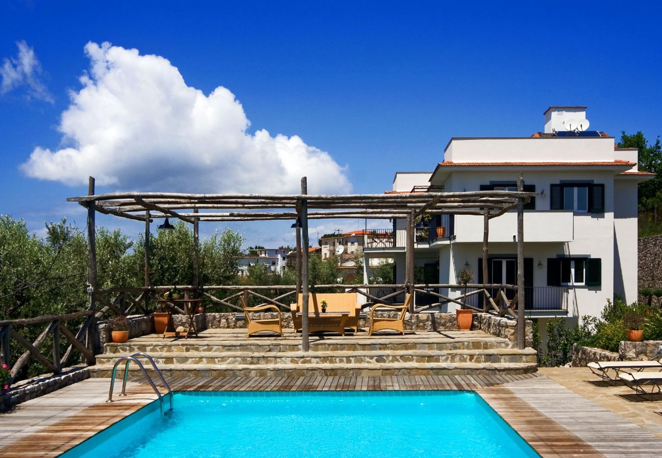 furnished solarium and pool, sunny day, holiday residence le capannelle, rigoletto, sant'agata sui due golfi, italy