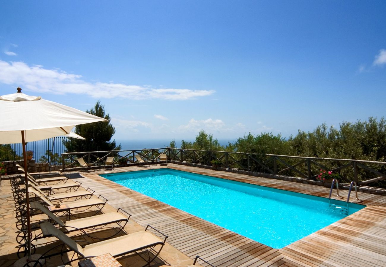 swimming pool and solarium with sunbeds and sunbrella, holiday apartment rigoletto, sant'agata sui due golfi, italy