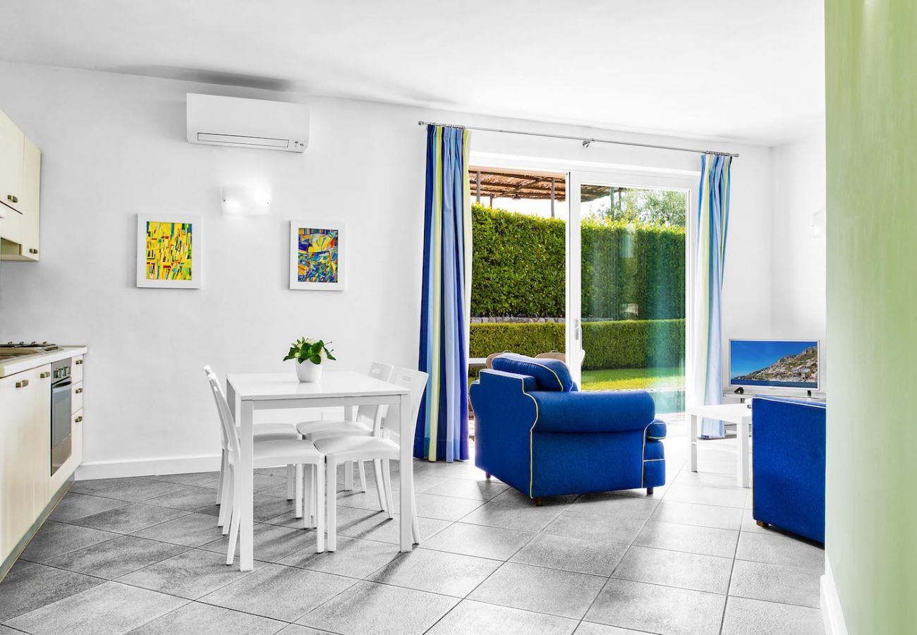 bright and modern living room, blue sofas, holiday apartment tosca, sant'agata sui due golfi, italy
