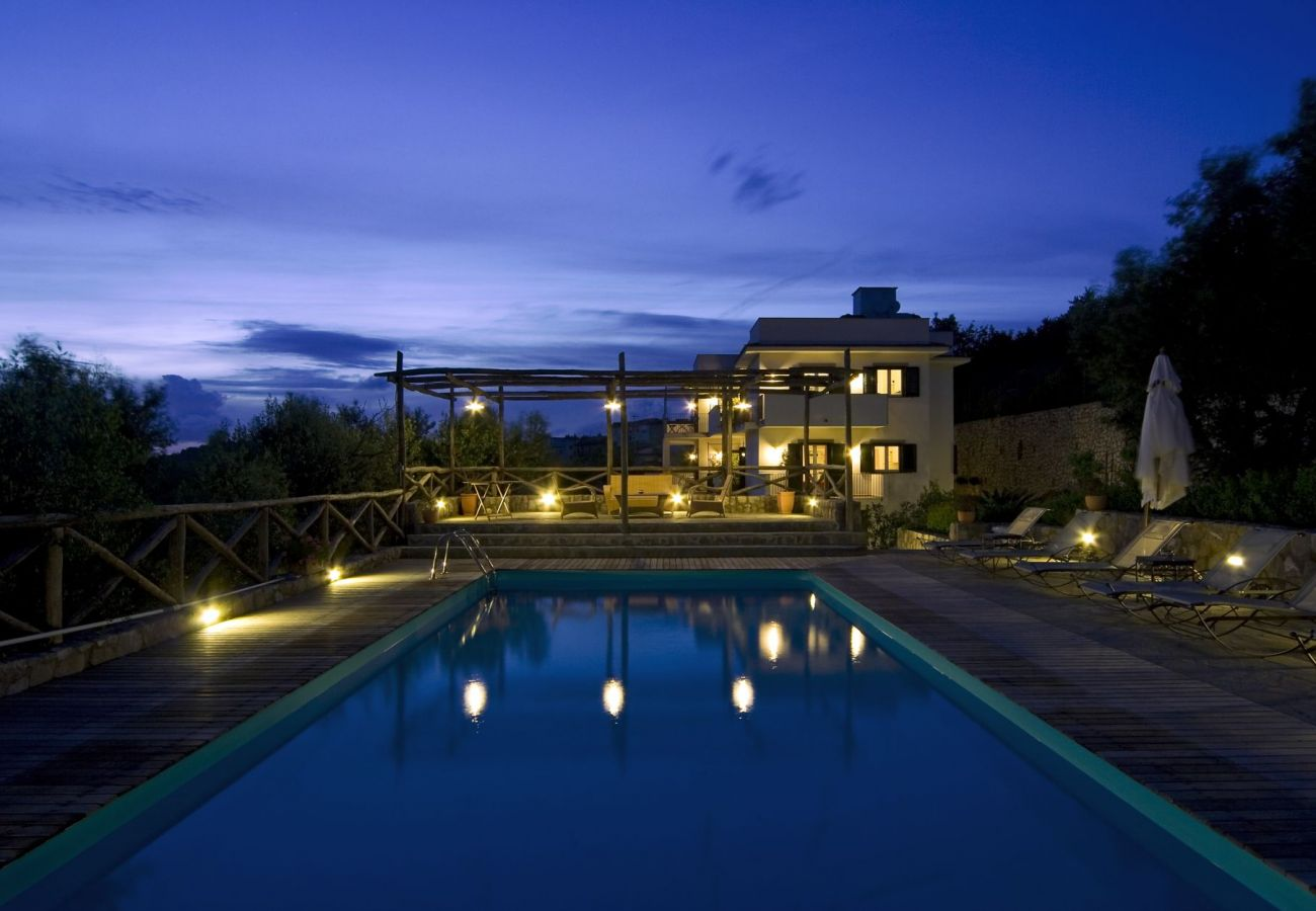 pool area at night with le capannelle residence on back, holiday apartment figaro, sant'agata sui due golfi, italy