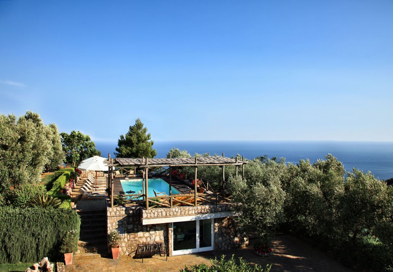 pool area view, sunny day, le capannelle residence, holiday apartment figaro, sant'agata sui due golfi, italy