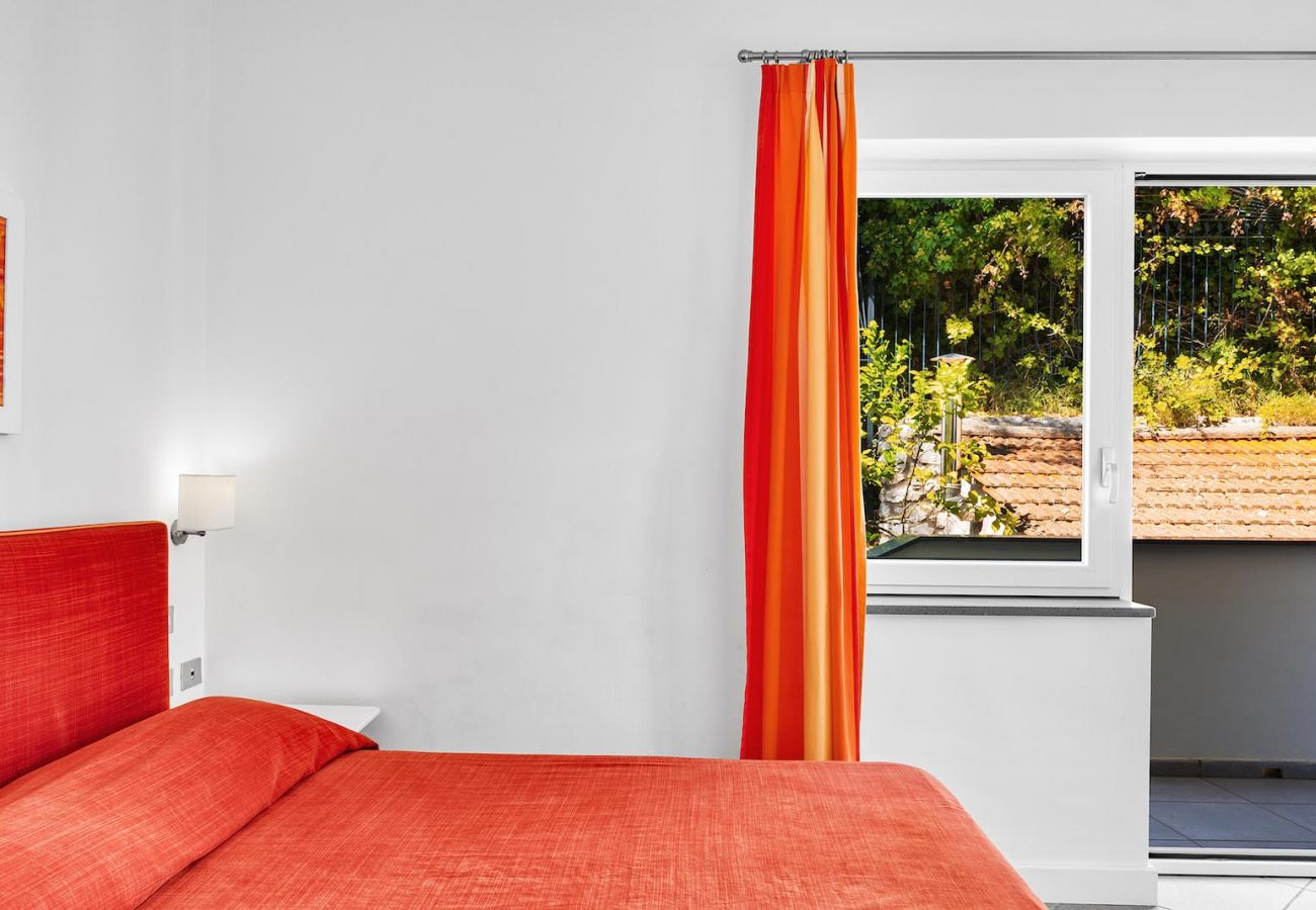 double bedroom, orange style, figaro apartment, le capannelle massa lubrense