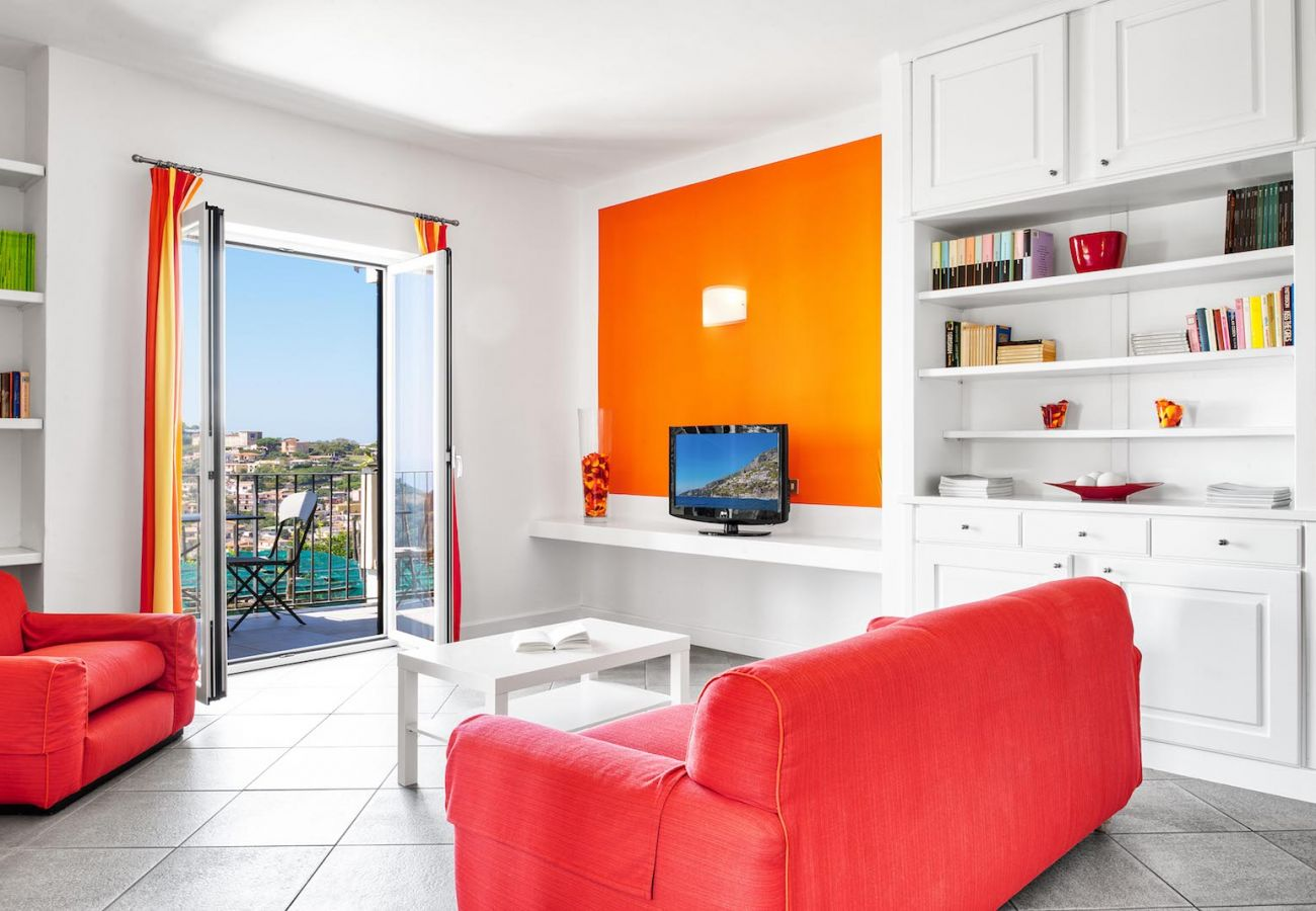 bright living room, in orange, boheme holiday apartment of le capannelle residence