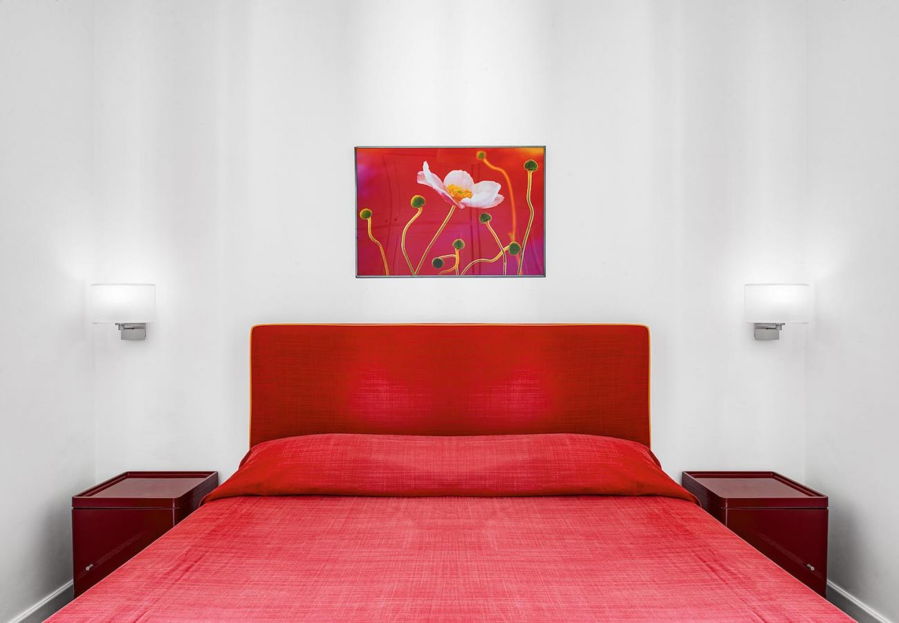 double bedroom with red bedroom and furnitures, boheme apt