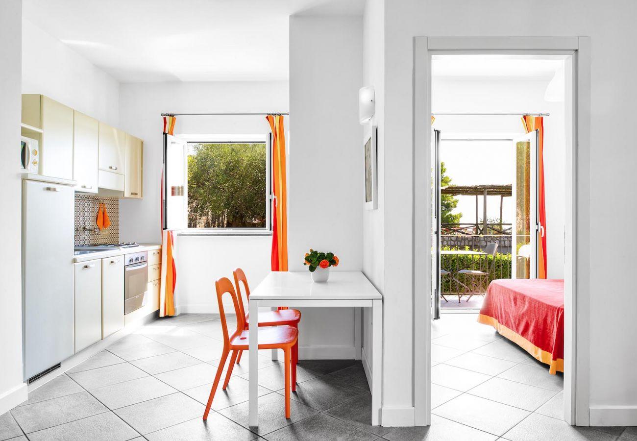 kitchen corner and double bedroom with balcony, boheme apartment