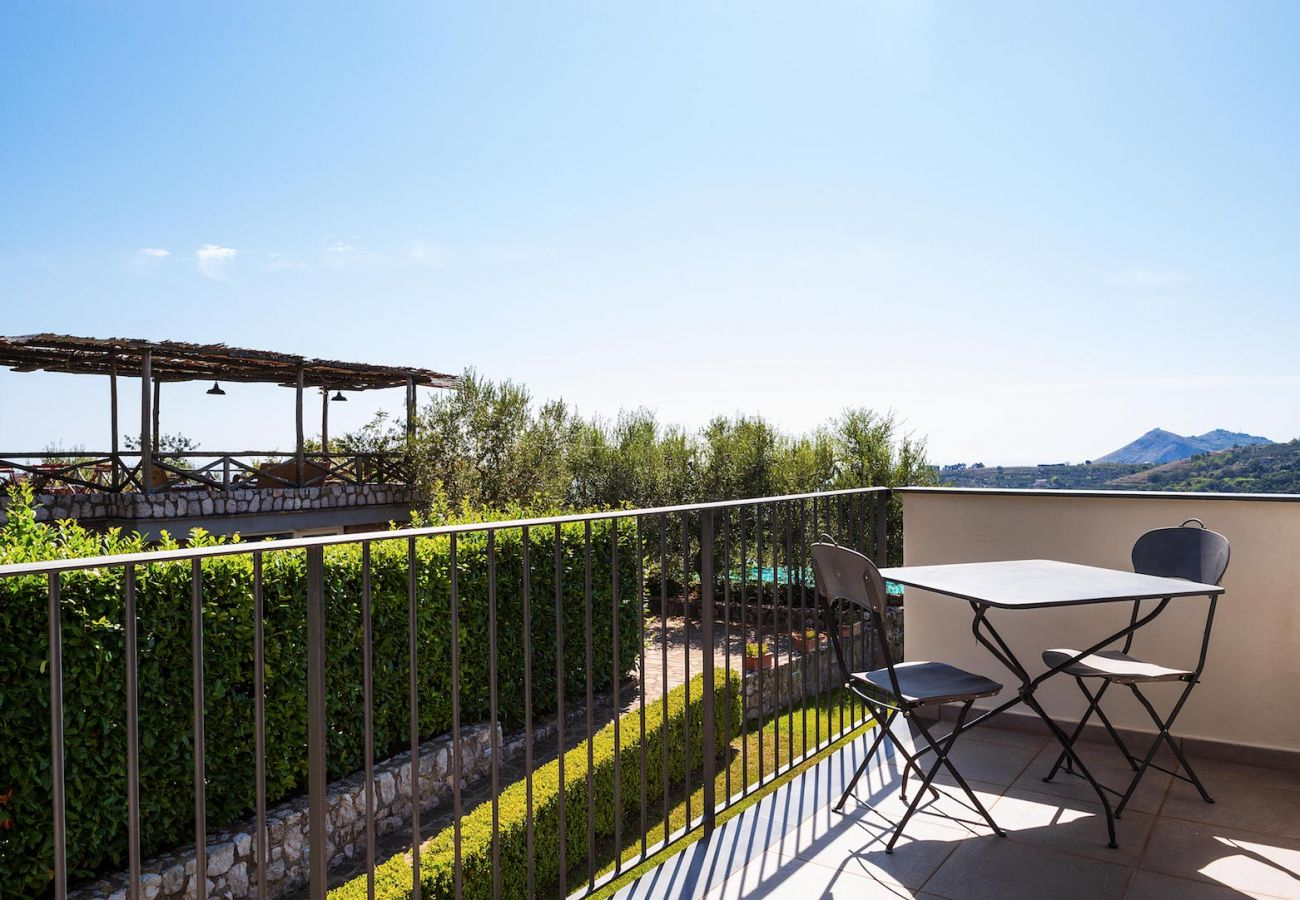 panoramic terrace corner with little iron table and chairs, boheme holiday apt