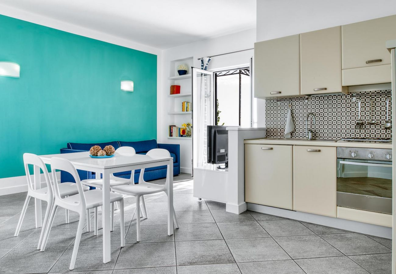 bright kitchen and dining area, carmen apartment, le capannelle massa lubrense