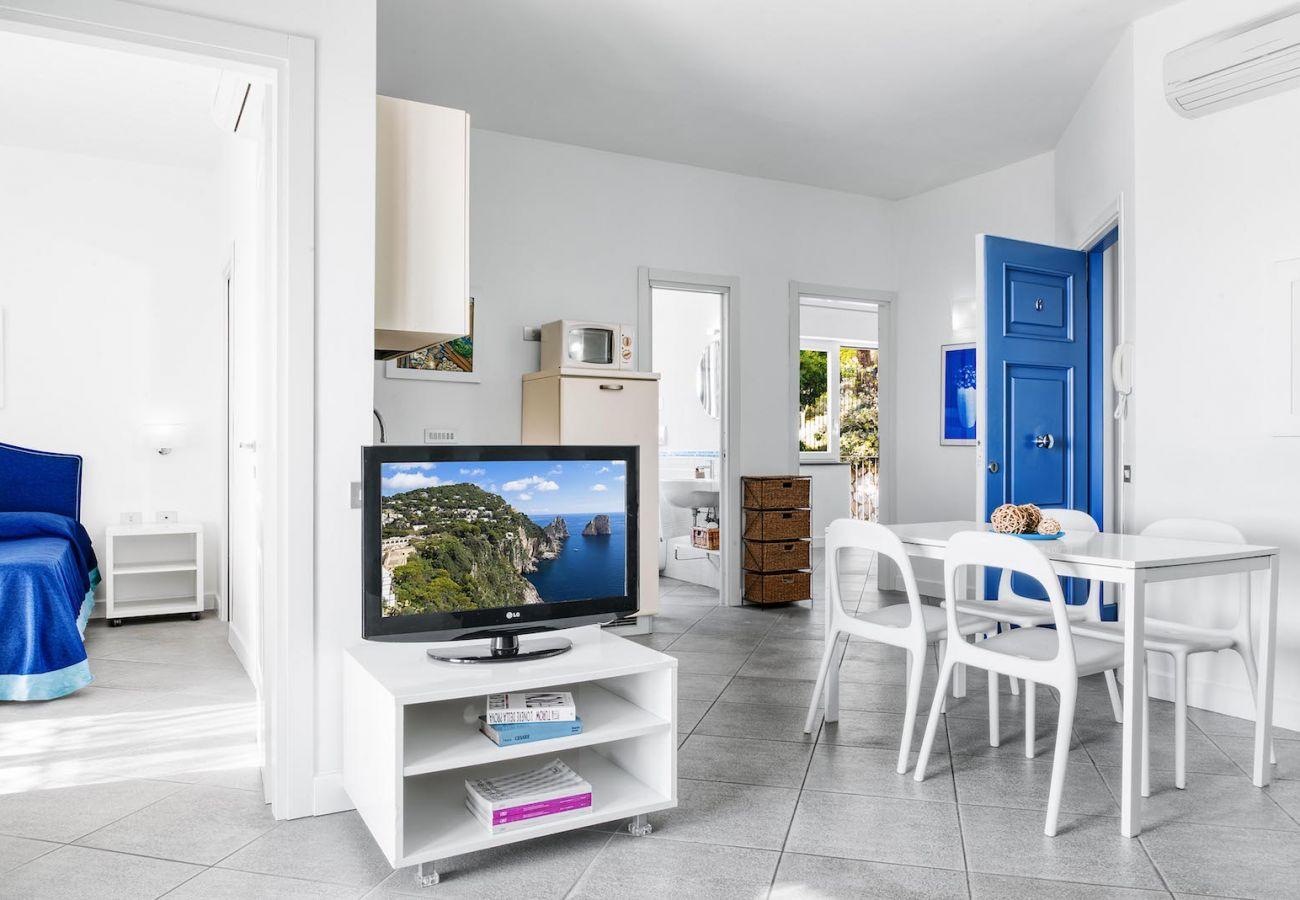 living area, in blue, holiday apartment carmen, massa lubrense