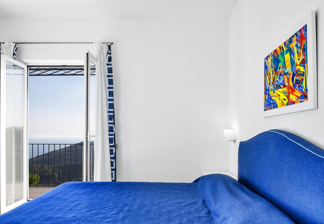 double bedroom, in blue, with opened panoramic balony, carmen apartment