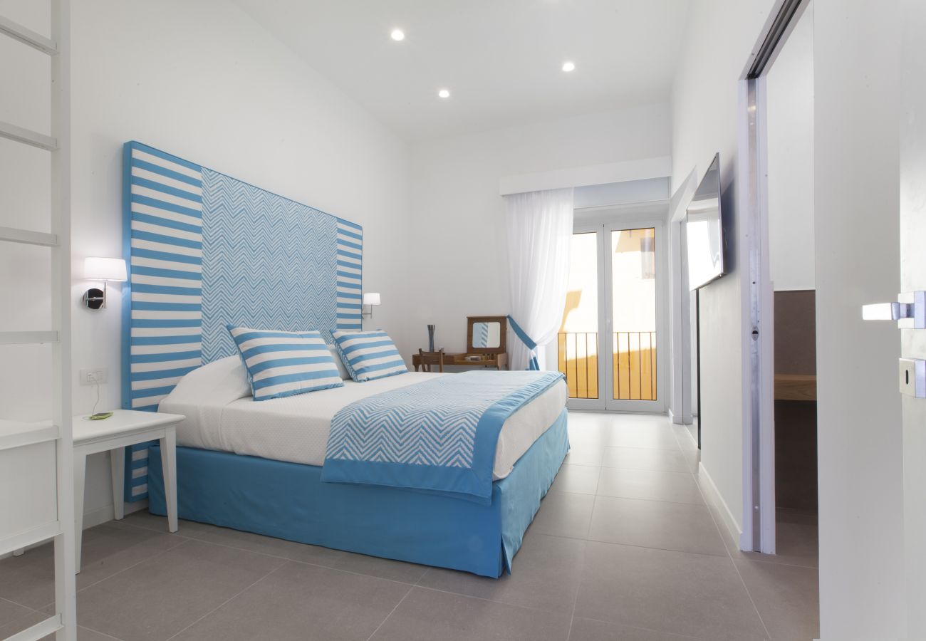 bright modern in light blue double bedroom , holiday home blue suite, sorrento, italy
