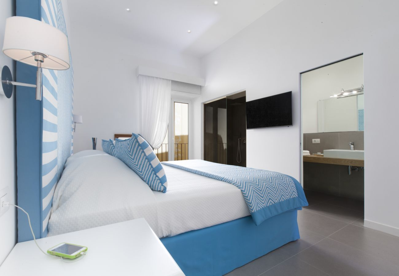 modern bright double bedroom with separate wide shower cabin from ensuite, holiday home blue suite, sorrento, italy