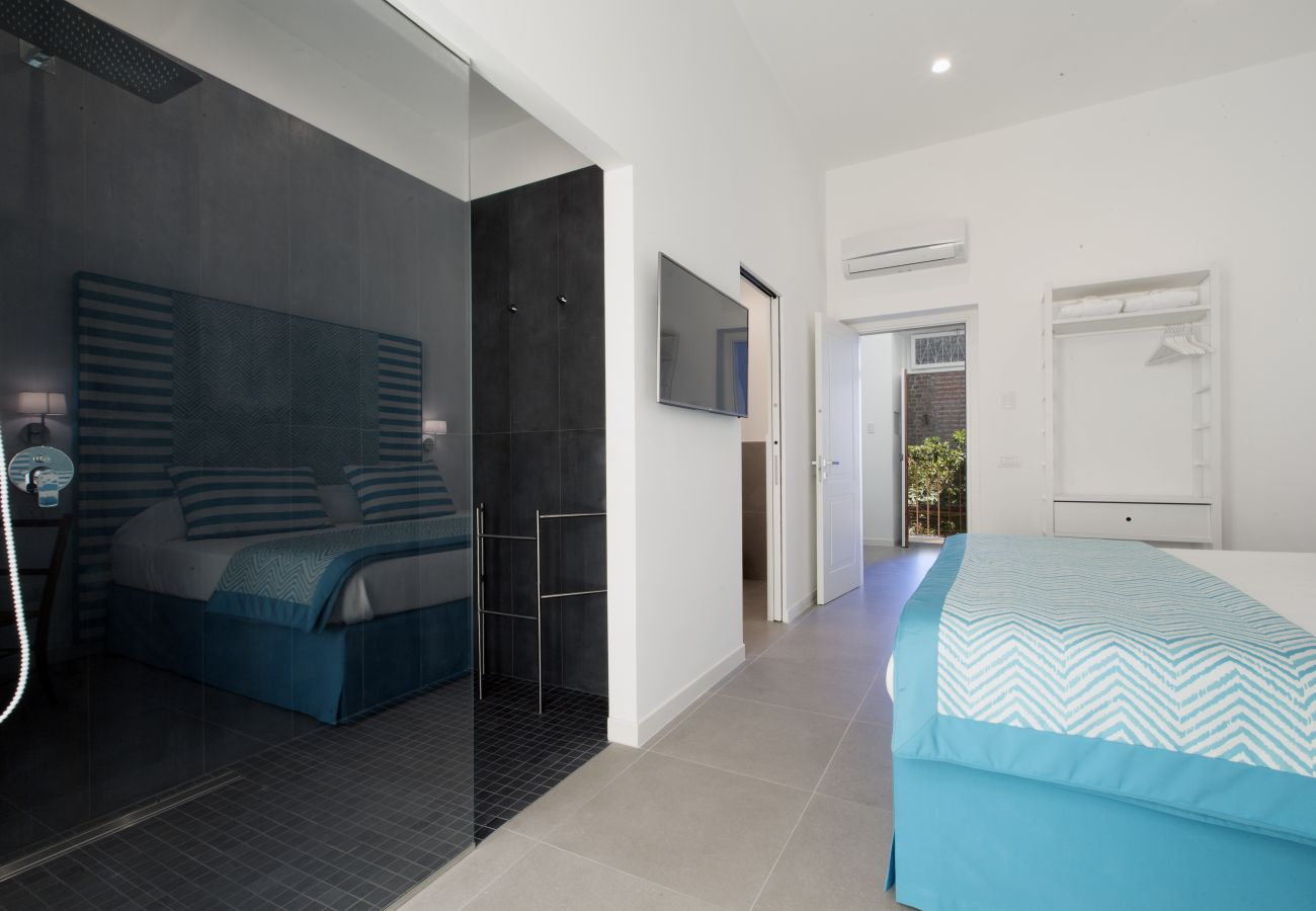 wide shower cabin in modern double bedroom, holiday home blue suite, sorrento, italy
