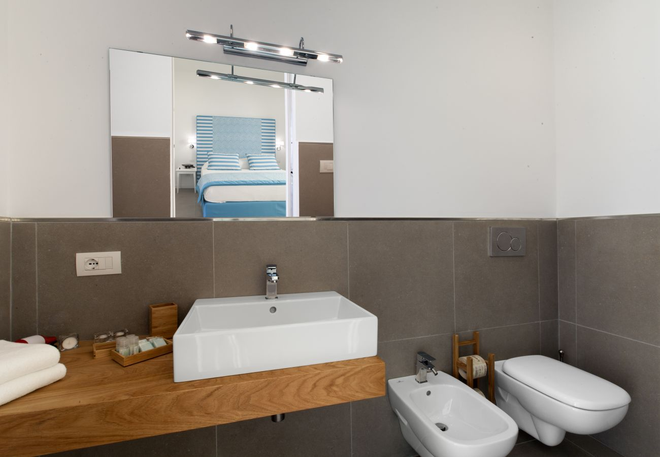 modern style bathroom, holiday home blue suite, sorrento, italy