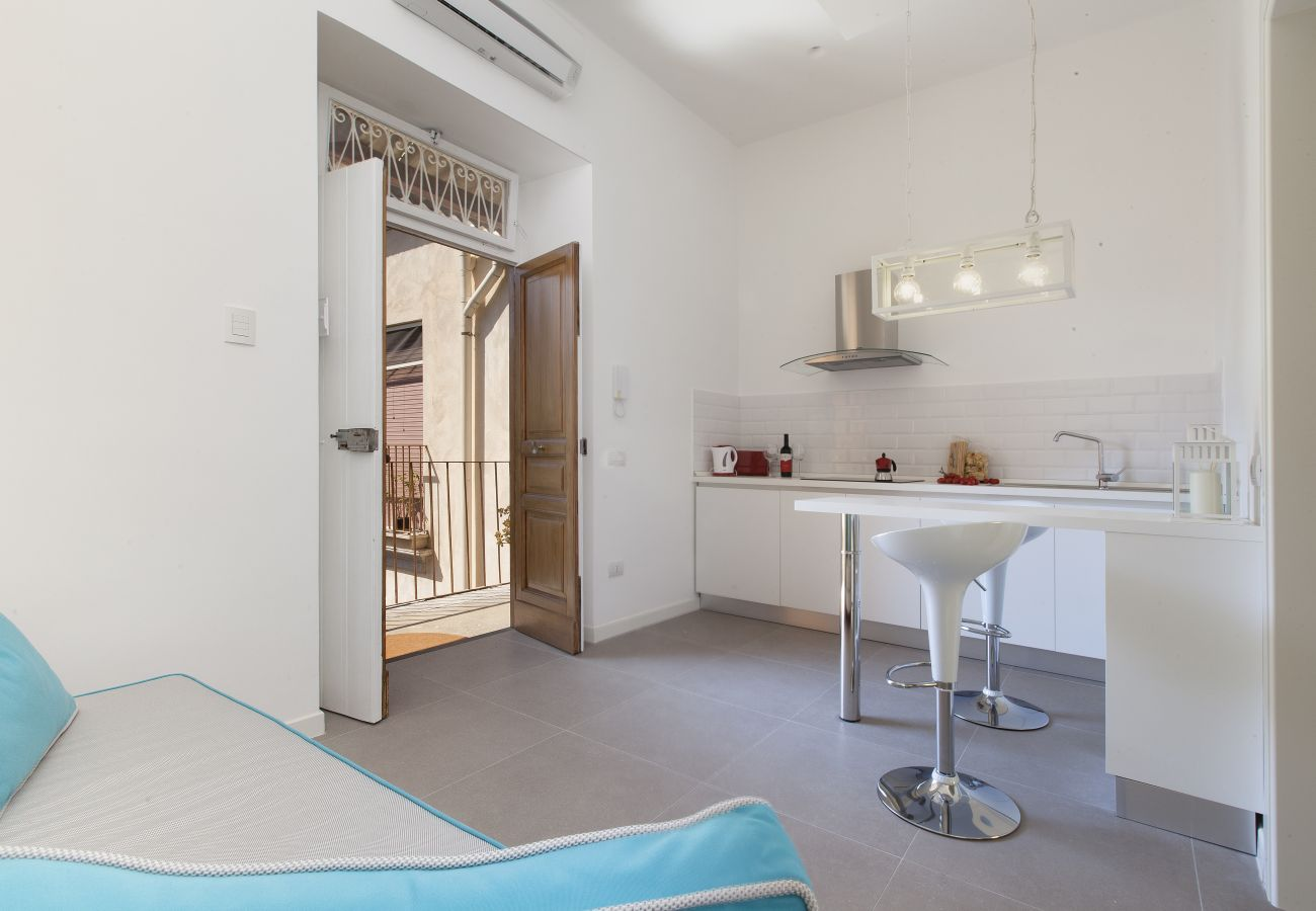 kitchen with sofa and patio access, holiday home blue suite, sorrento, italy