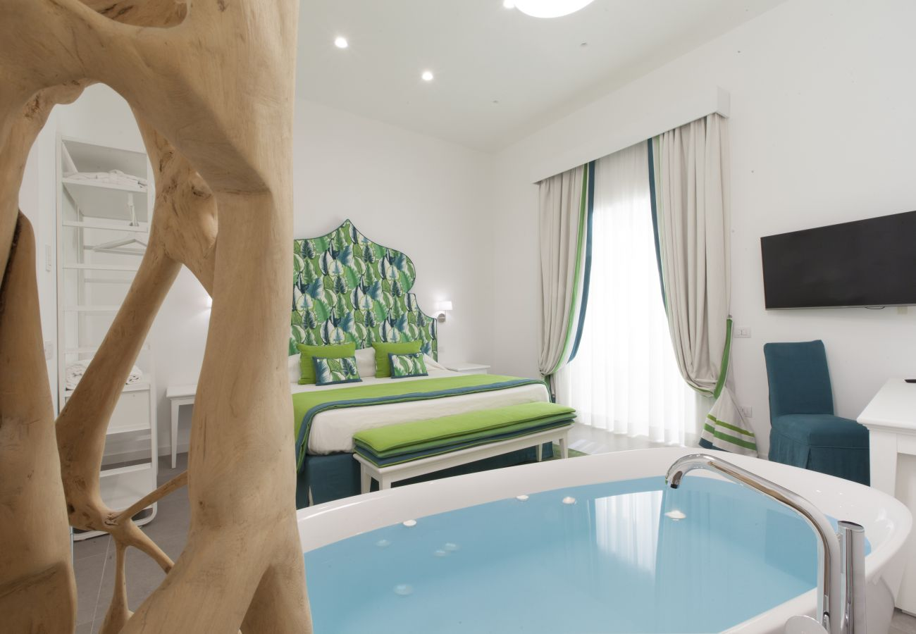 modern double bedroom with bath & tv, holiday apartment green suite, sorrento, italy