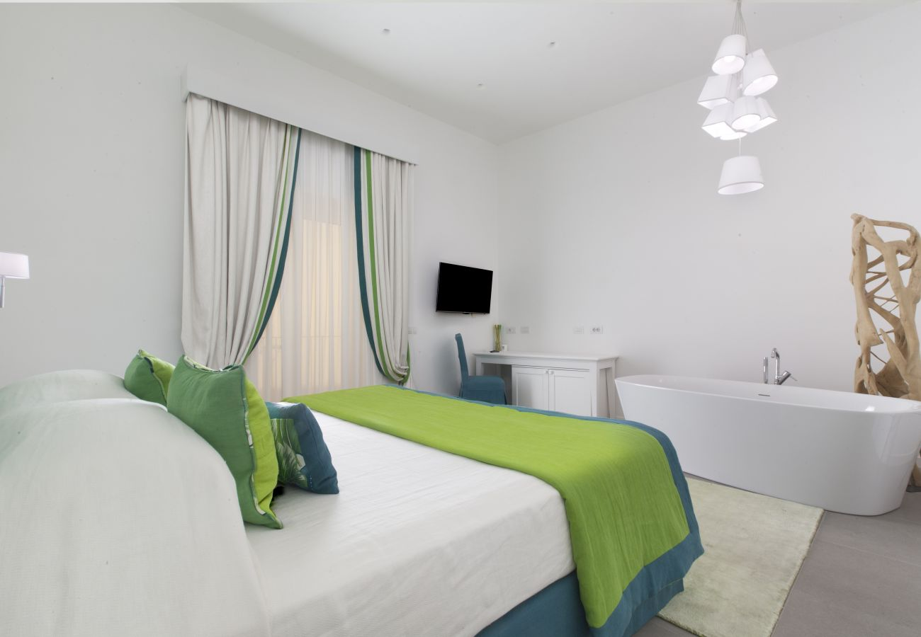 double bedroom with bath and tv, holiday apartment green suite, sorrento, italy