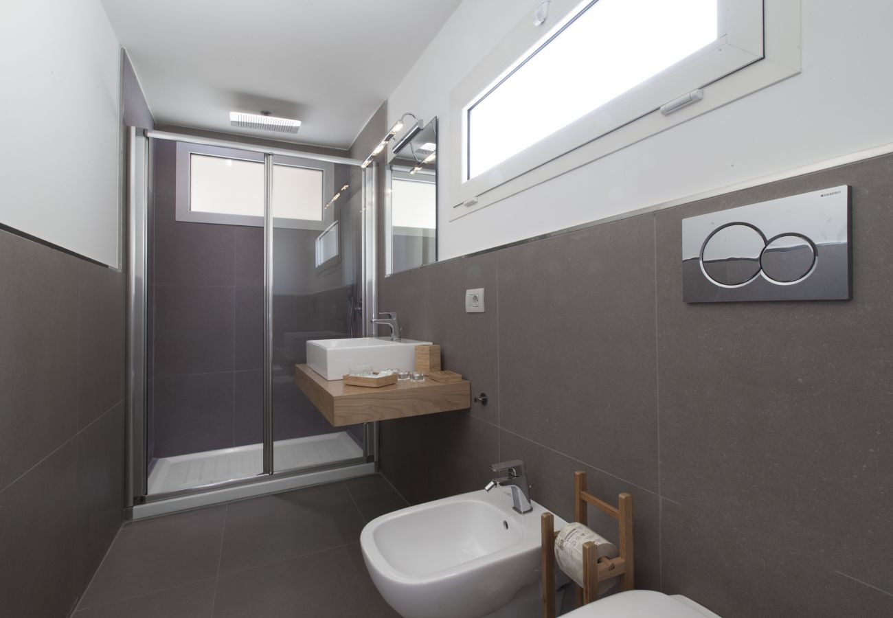 wide modern bathroom with two windows, holiday apartment green suite, sorrento, italy