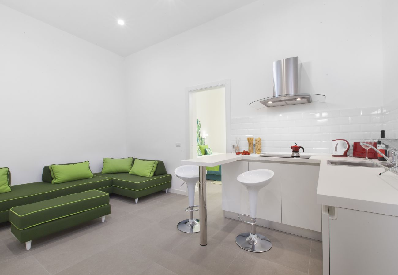 modern kitchen with living corner in green, holiday apartment green suite, sorrento, italy