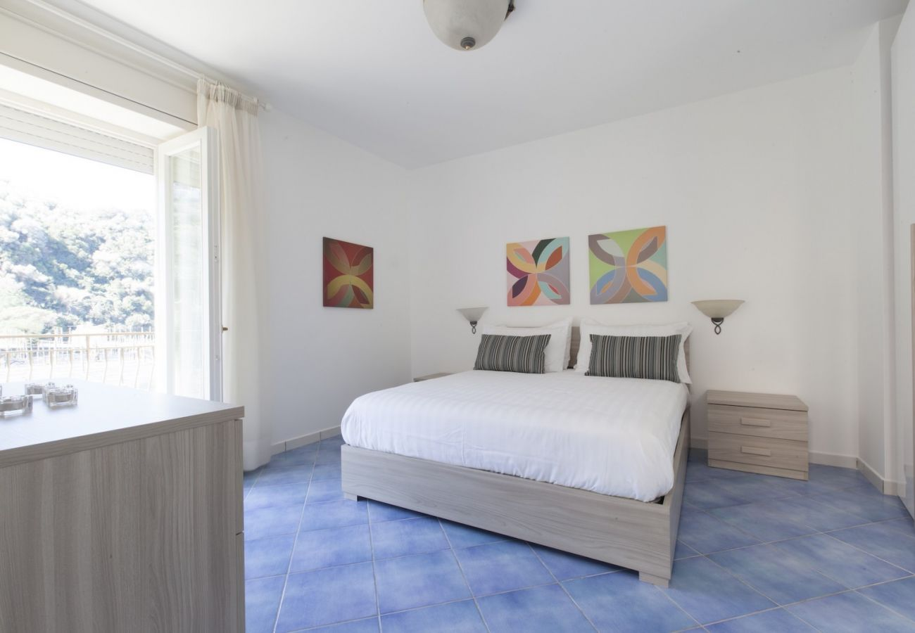 double bedroom with balcony holiday apartment massa lubrense tetto bianco