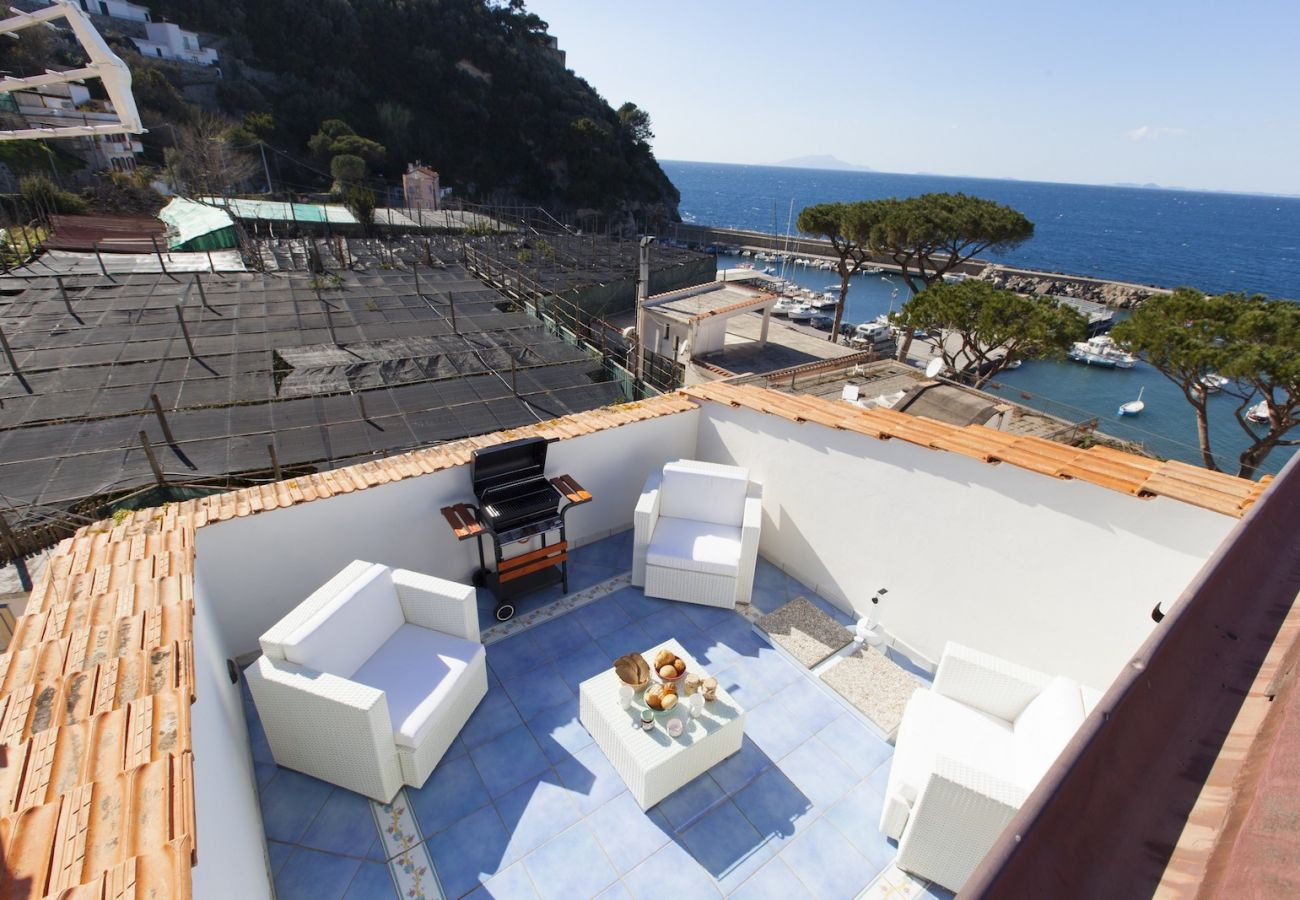 furnished terrace with garden chairs, bbq and sea view, tetto bianco apt