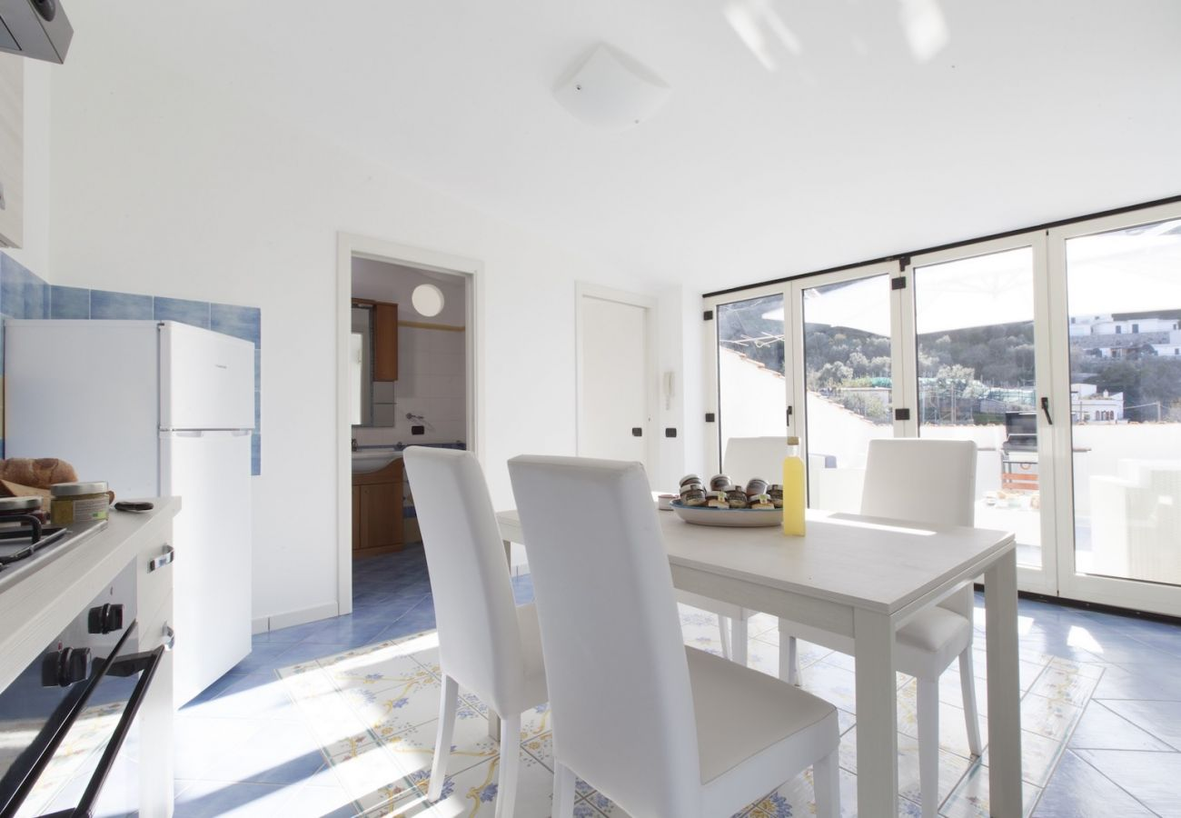 bright little kitchen with terrace and bathroom