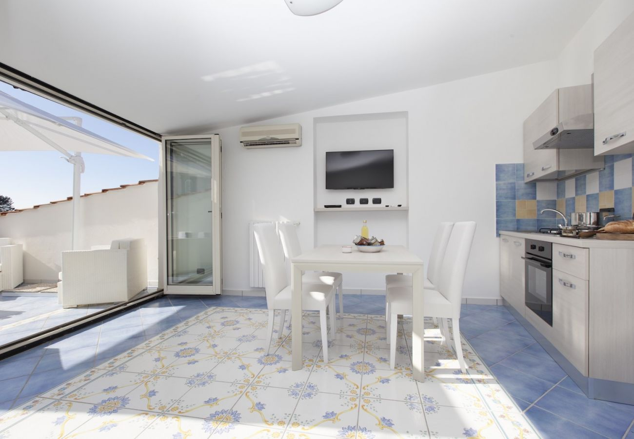 pretty bright kitchen with terrace entrance, tetto bianco holiday apartment
