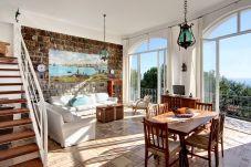 bright living area with stunning sea view, marina del cantone