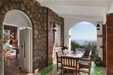 patio with table, chairs and sea view, casa del capitano massa lubrense