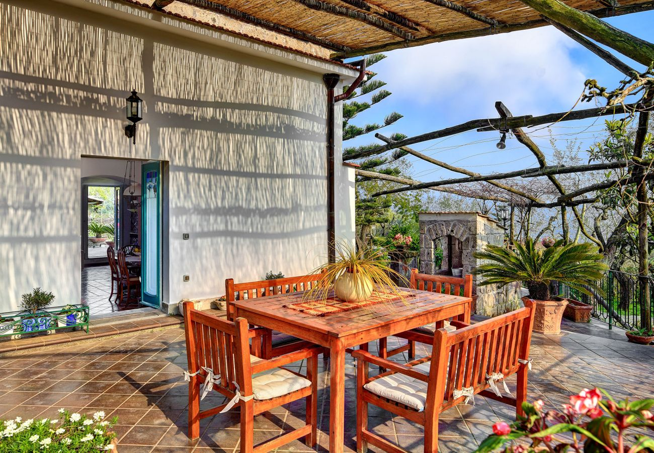 outdoor furnished patio during a sunny day, villa le birbe