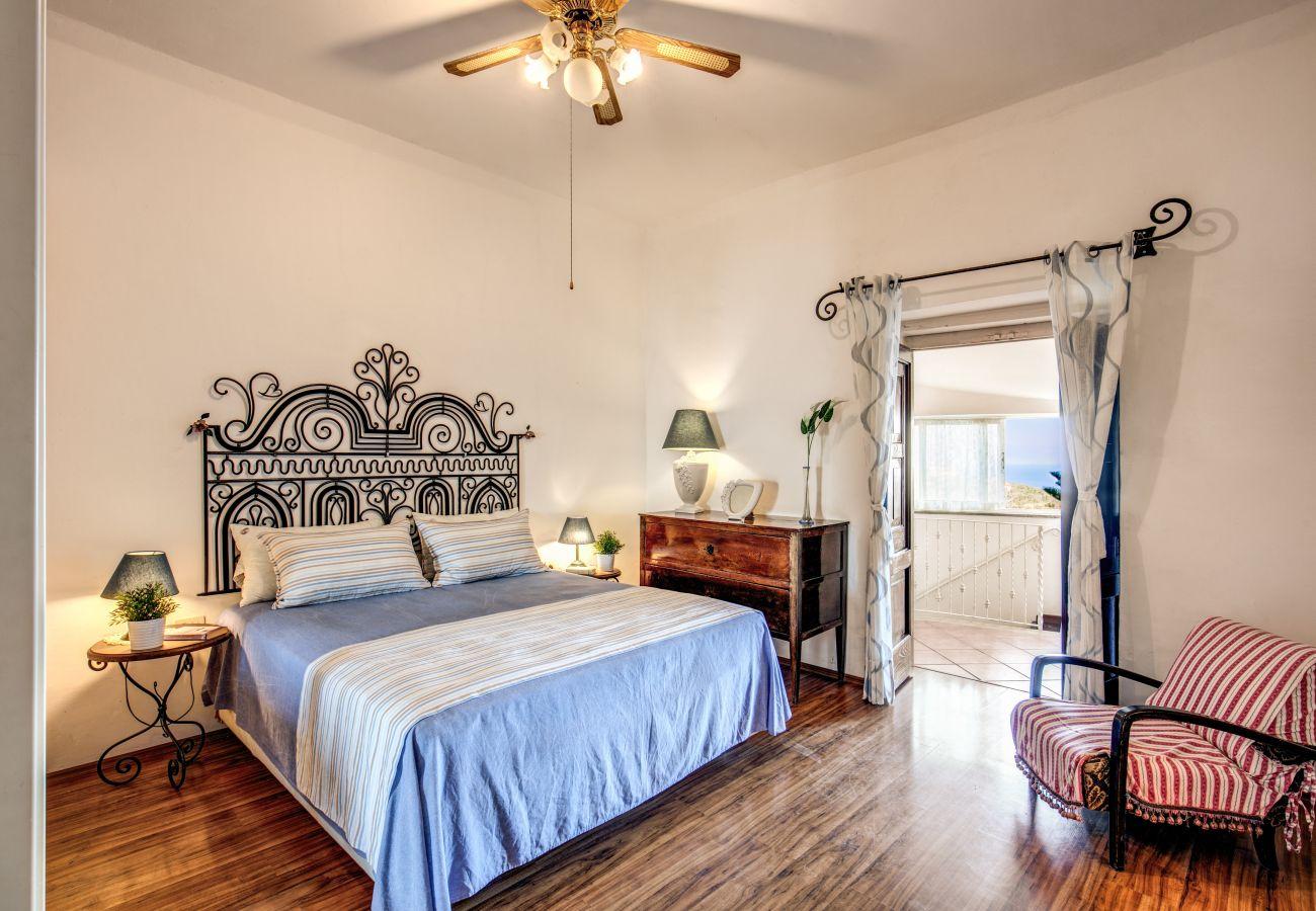 double bedroom with balcony, villa the retreat of the senses on the amalfi coast