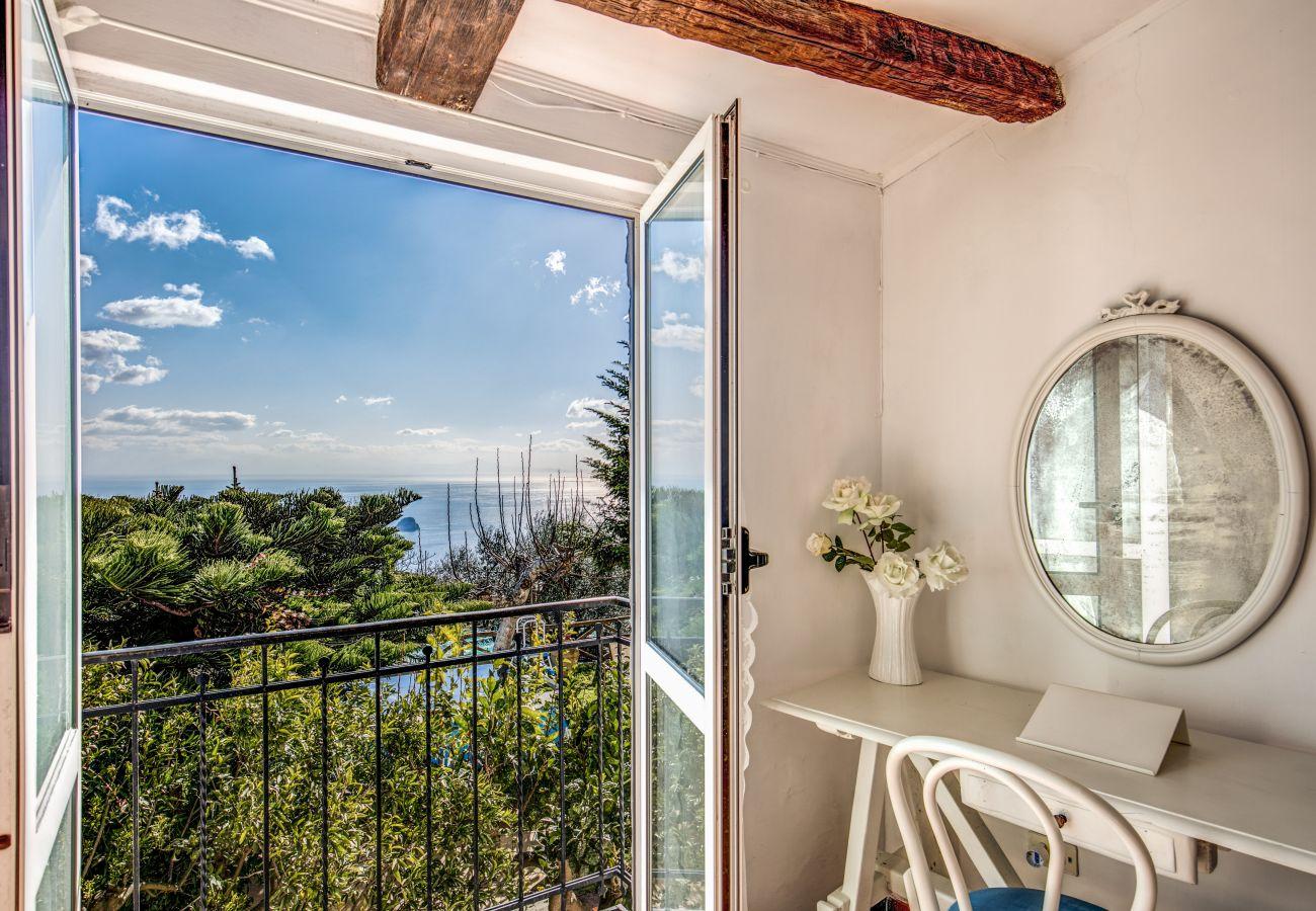 bedroom with open balcony and panoramic sea view, villa rental amalfi coast