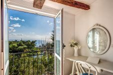 bedroom with open balcony and panoramic sea view, villa rental amalfi coast