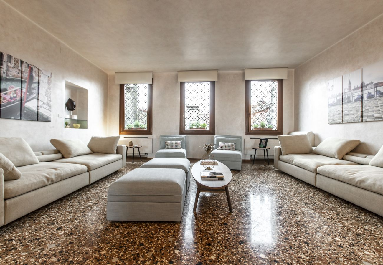 Spacious and bright living room with large sofas