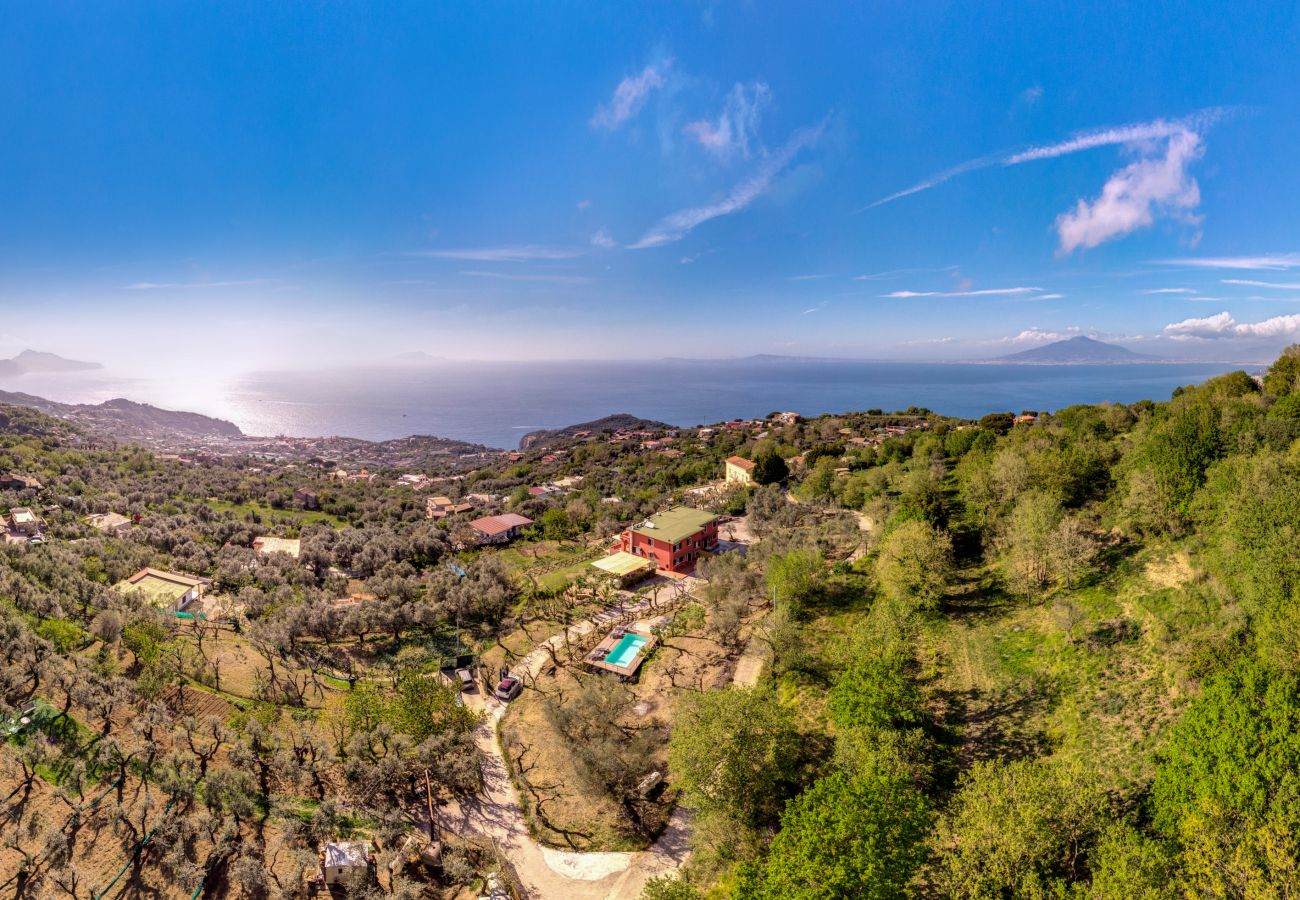 vacation villa with pool and view overlooking capri island and amalfi coast, drone photo