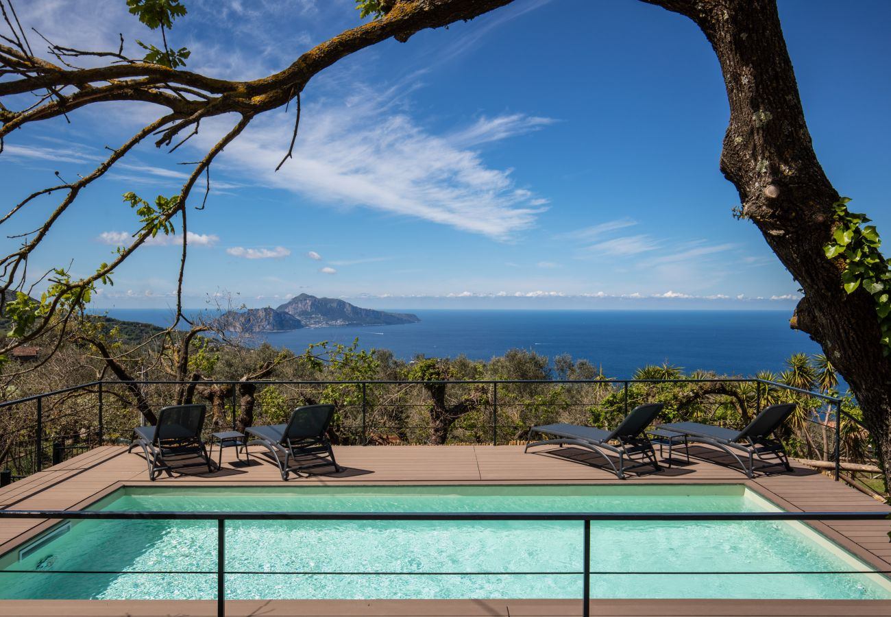 panoramic views overlooking capri island and the amalfi coast, from the pool side