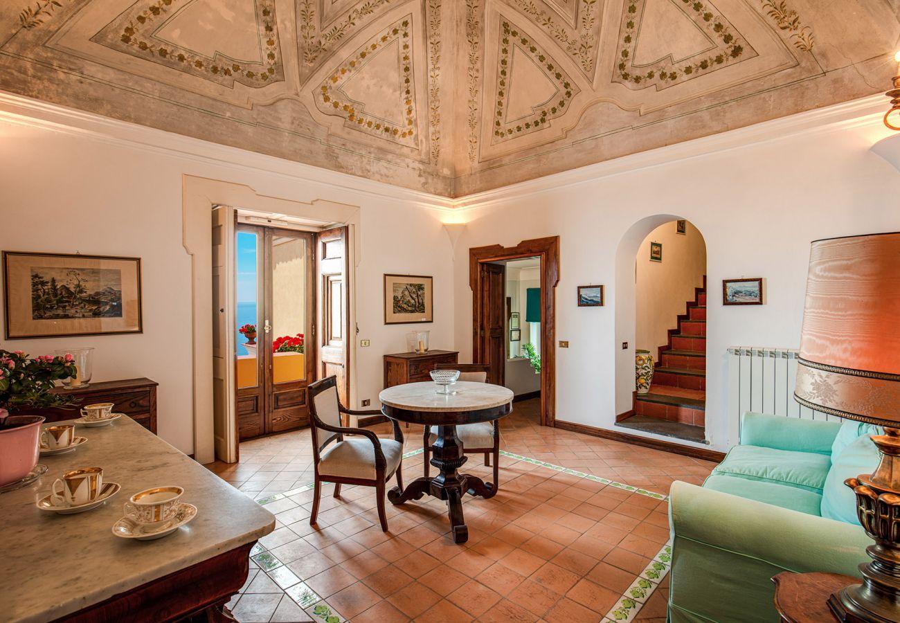 bright classic living room with balcony, casa marina positano