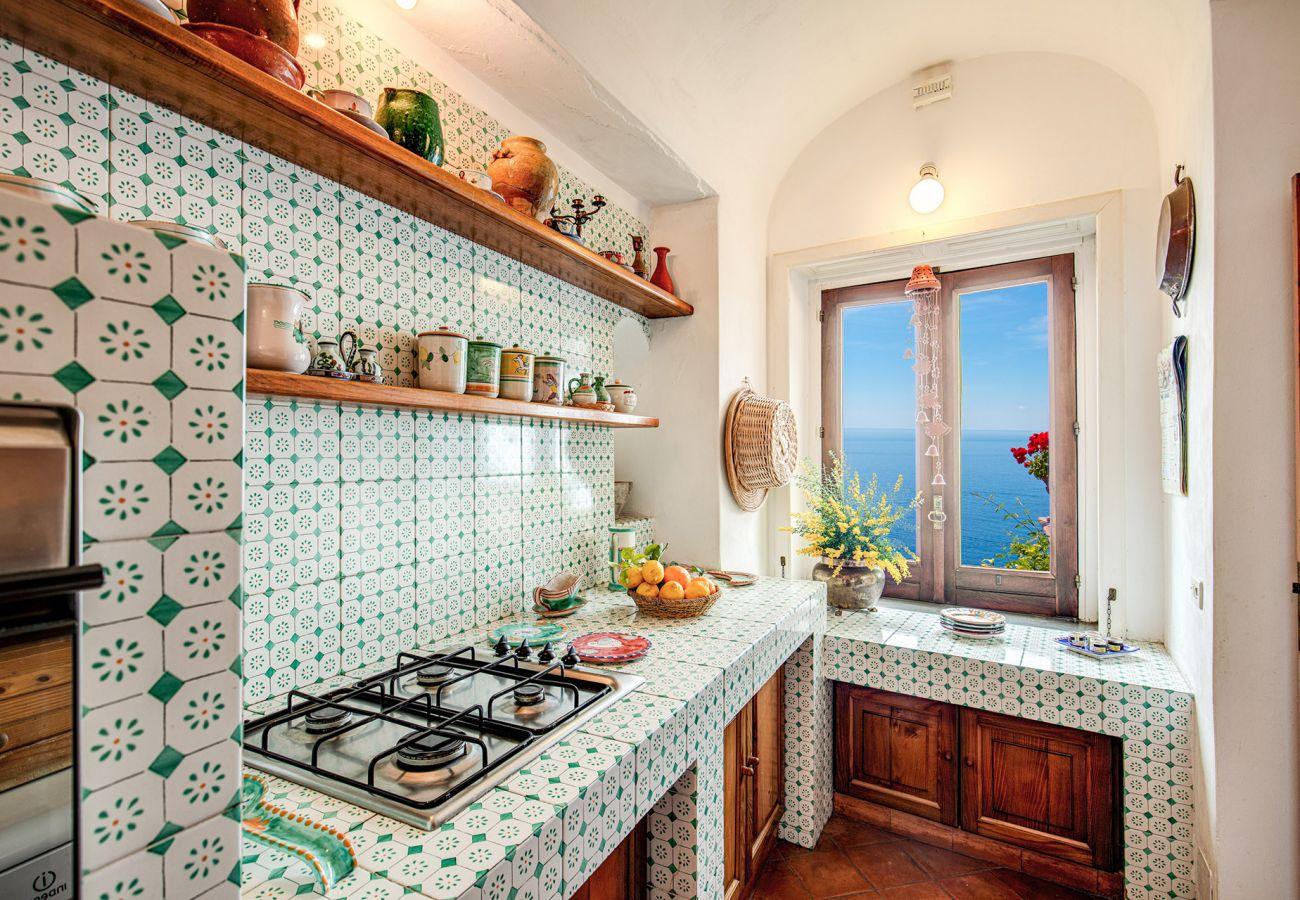 kitchen with sea view window, positano italy, casa marina