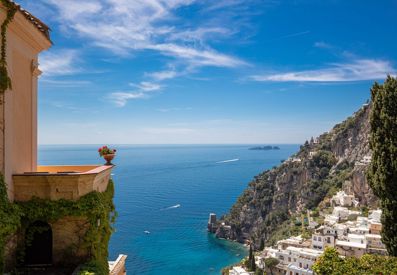 classic terrace side with view overlooking positano and sea
