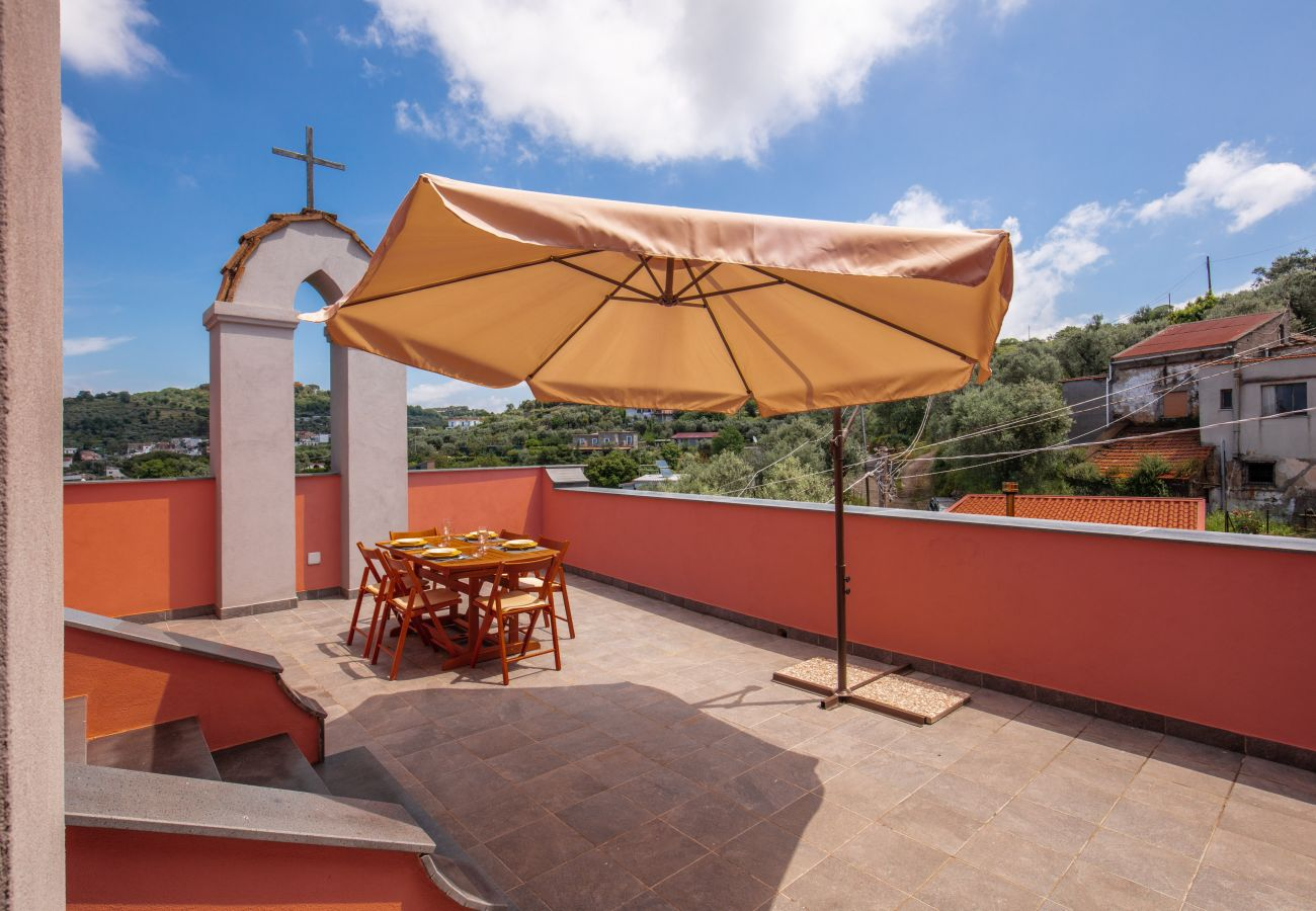 terrace with table and chairs for meals, and sun umbrella