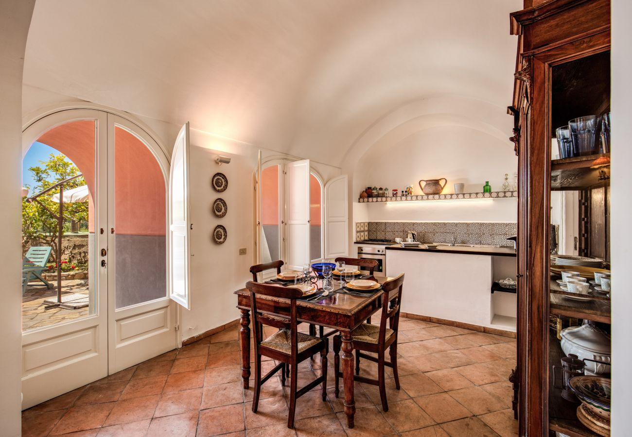 bright dining area with garden access and kitchenette, v. cartnì