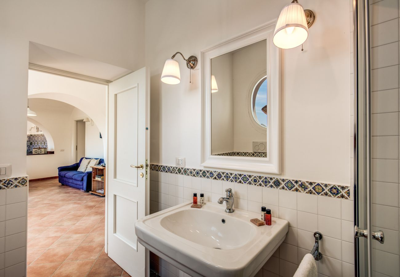 bathroom with sink and mirror, first floor