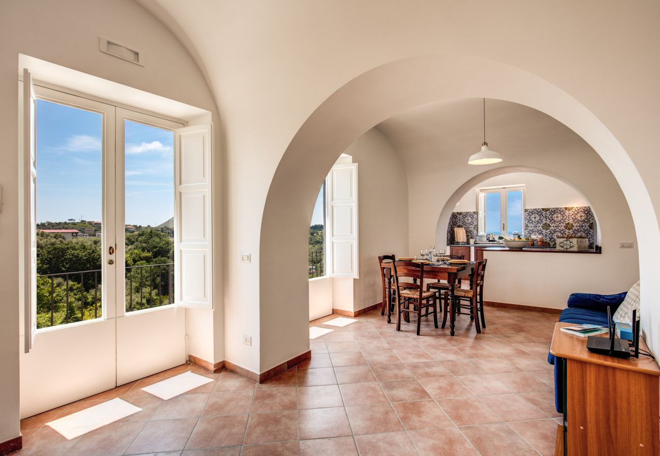 charatteristic living and dining area, with arch