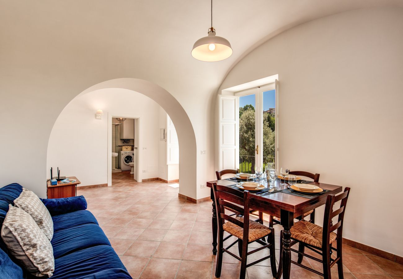 dining and living area with panoramic balcony, villa cartnì