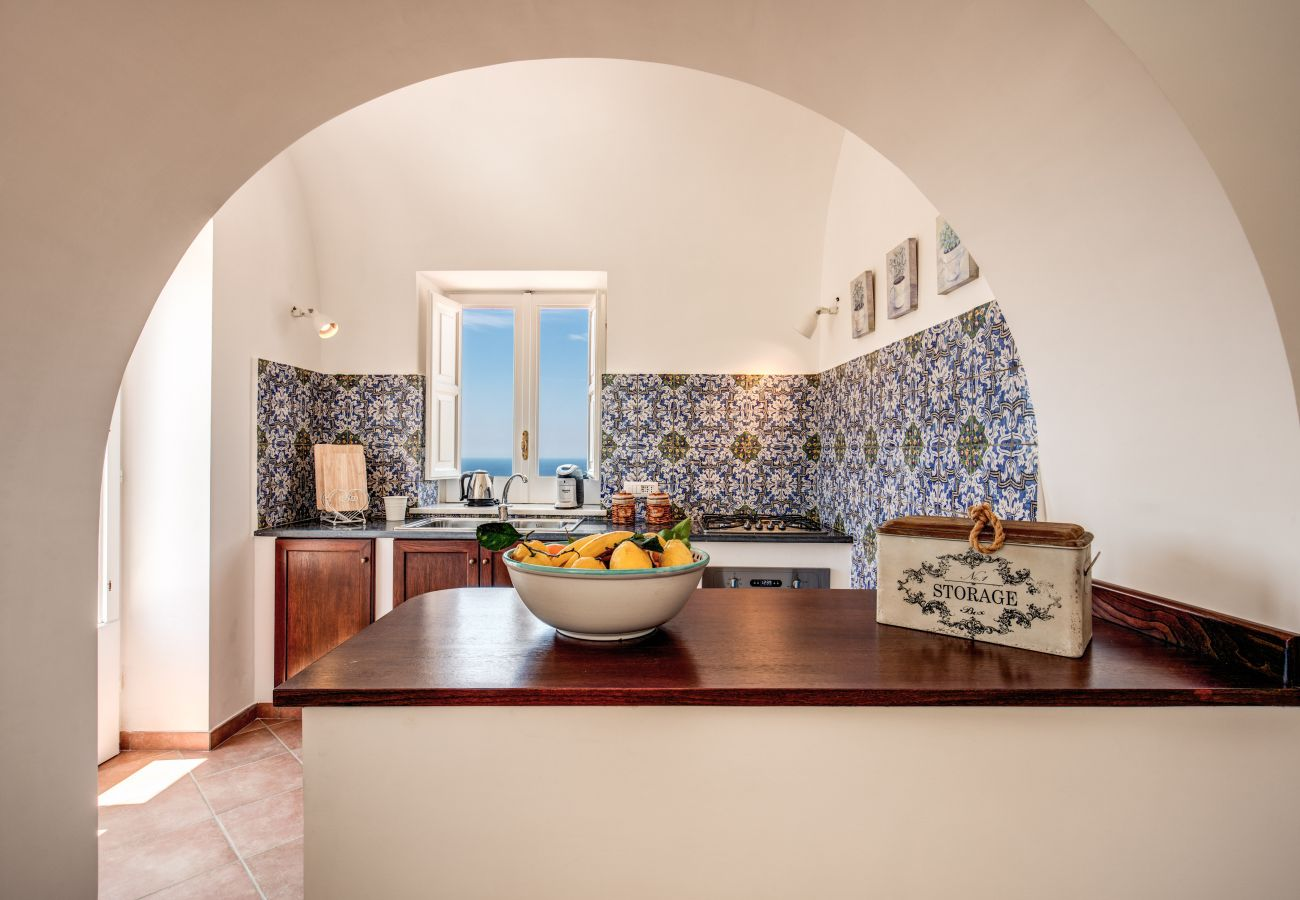 bright kitchenette with panoramic balcony and window