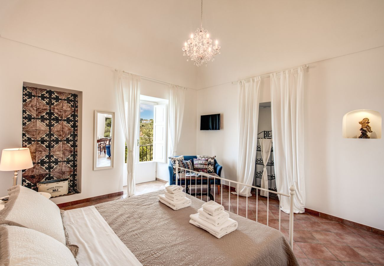 double bedroom with tv and panoramic balcony, v. cartnì