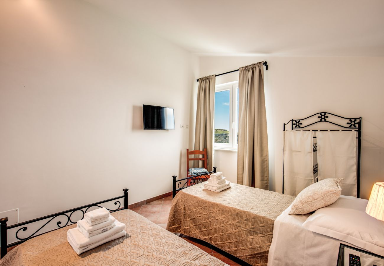 bright twin bedroom with panoramic balcony and tv