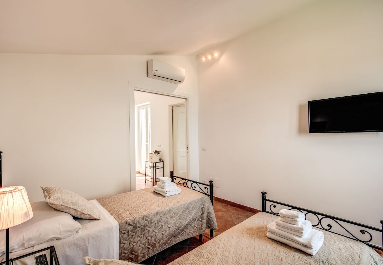 twin bedroom with air conditioning and tv