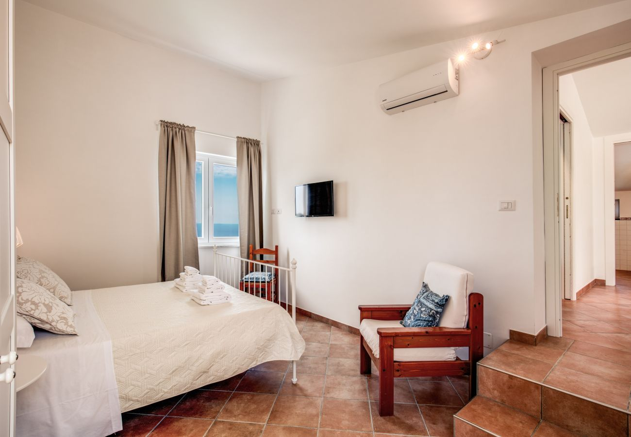 double bedroom with tv and air conditioner